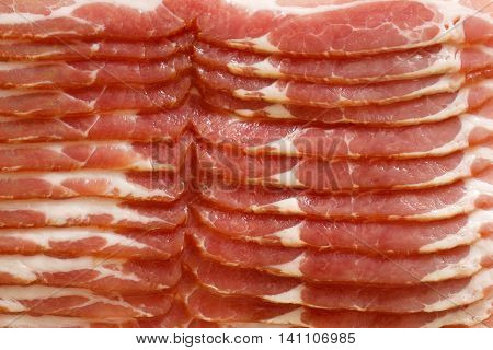 Detail Of Strips Of Streaky Uncooked Bacon Isolated On White From Above.