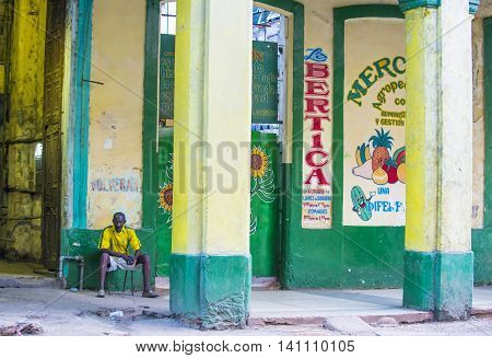 HAVANA CUBA - JULY 18 : A portrait of a Cuban man in old Havana street on July 18 2016. The historic center of Havana is UNESCO World Heritage Site since 1982.