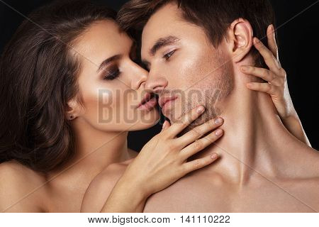 Sexy beauty couple.Kissing couple portrait.Sensual brunette woman in underwear with young lover, passionate couple foreplay closeup.Sexy couple in intimacy relations