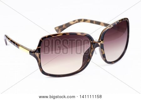 Woman's sunglasses with leopard pattern on white background