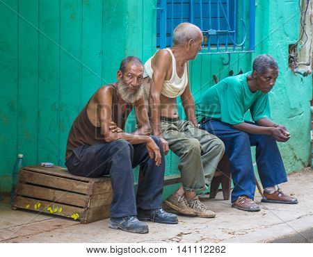 HAVANA CUBA - JULY 18 : Three Cuban men in old Havana street on July 18 2016. The historic center of Havana is UNESCO World Heritage Site since 1982.