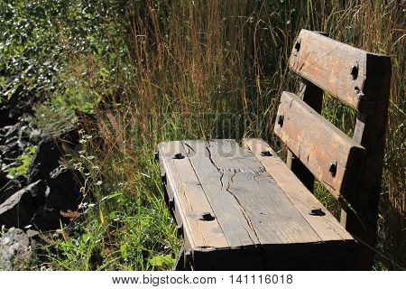 Country wooden bench by the river side