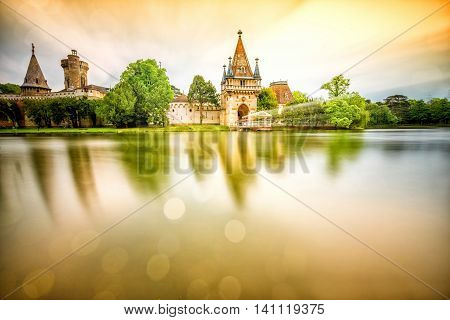 View on Franzensburg castle in Laxenburg town in Austria. Long exposure effect with glossy water and reflection.