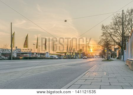 Regensburg, Bavaria, Germany - March 18, 2016: This picture shows a street in Regensburg near Gewerbepark during sunset.