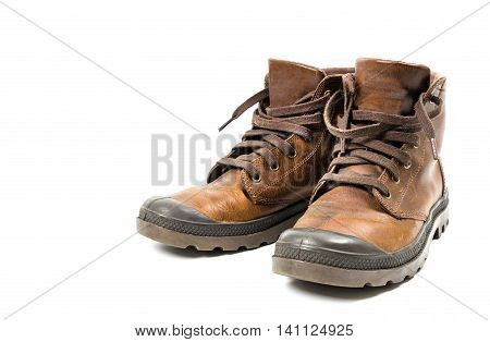 Pair of dirty old leather boots isolated on white. Photo with clipping path.