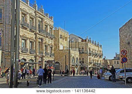 JERUSALEM, ISRAEL, OCTOBER 23, 2013 Street entrance to Old Jerusalem just inside Jaffa Gate busy with tourists visiting shops.