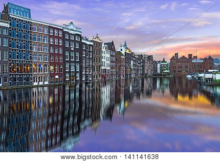 Panorama of typical dutch houses in Amsterdam next ti a canal