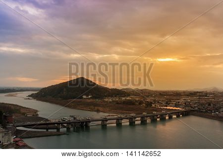 Landscape Of Inuyama City View With Mountain And Kiso River At Sunset