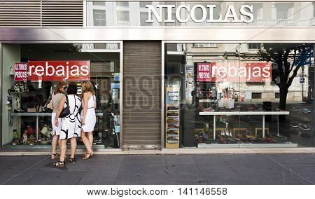 SEVILLE, SPAIN - September 14, 2015: Three unidentified women discussing shoes. Shoes are the second girl's best friend rapidly overtaking diamonds, on September 14, 2015 in Seville, Spain