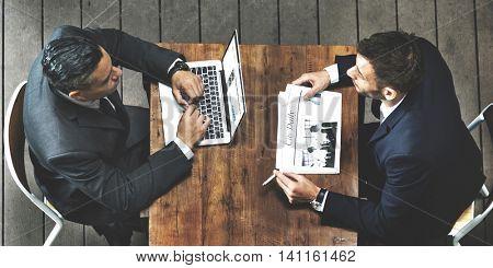 Businessmen Computer Newspaper Smoking Concept