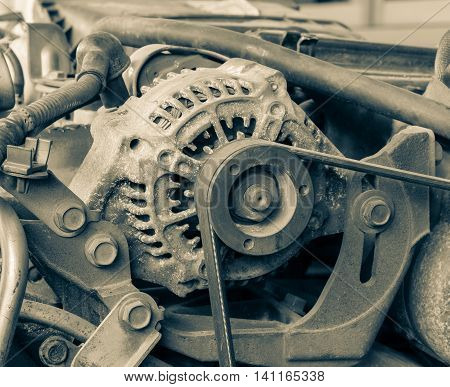 Old alternator for the car attached on engine vintage effect