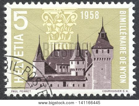 MOSCOW RUSSIA - CIRCA APRIL 2016: a post stamp printed in SWITZERLAND shows Nyon Castle and Corinthian Capital dedicated to the 2000th anniversary of Nyon circa 1958
