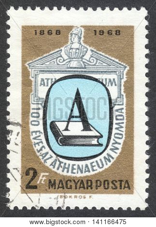MOSCOW RUSSIA - CIRCA APRIL 2016: a post stamp printed in HUNGARY shows a book and a letter A dedicated to the 100th Anniversary of the Athenaeum Press Budapest circa 1969