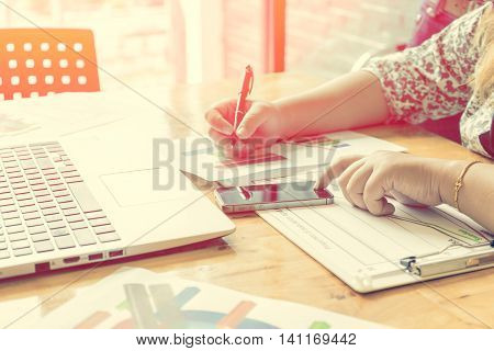 businessgirl working in office room with soft focus vintage tone