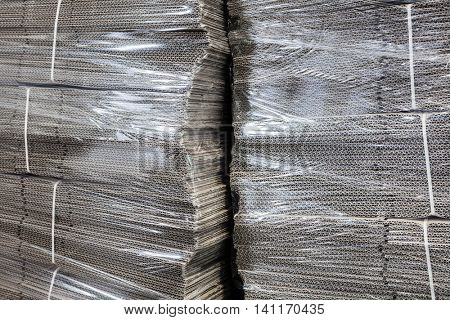 corrugated cardboard packaging in cellophane