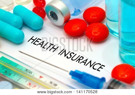 Health insurance. Treatment and prevention of disease. Syringe and vaccine. Medical concept. Selective focus