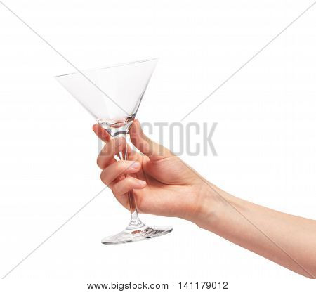 Female Hand Holding Empty Clean Martini Glass Against White