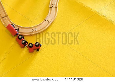 Red Wooden Toy Train Crashed Off Track.