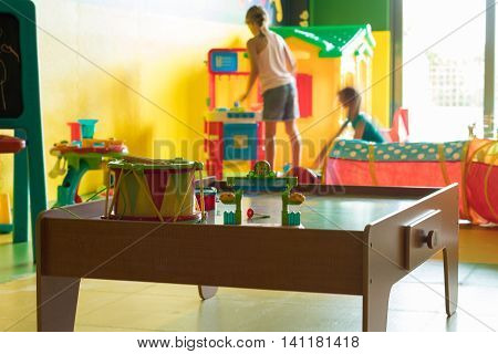 Two Young Children Playing In Playroom