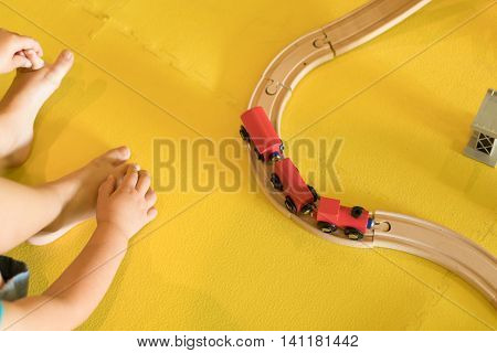Young Child Playing With Toy Train