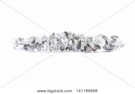 Colorful and crisp image of splintered tourmalinequartz chain on white background