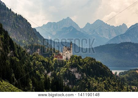 Castle Neuschwanstein in Germany. Mountains and lake