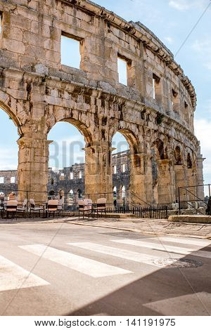 Architectural fragment of ancient roman amphitheatre in Pula city in Croatia.
