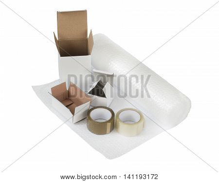 Cardboard boxes set, bubble wrap, cellotape. Packing and shipping concept