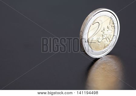 Closeup of two Euro coin on dark background with reflection