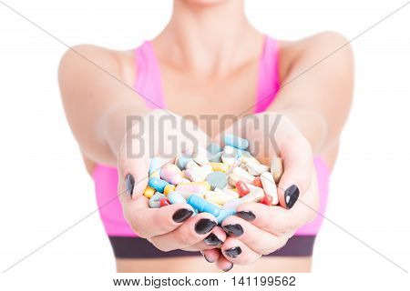 Close-up Of Woman Holding Pills Or Supplements