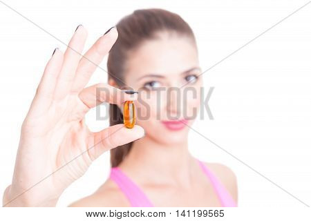 Close-up Of Girl At Gym Holding One Pill