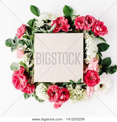 flat lay frame with craft box pink roses hydrangea branches leaves and petals isolated on white background. top view