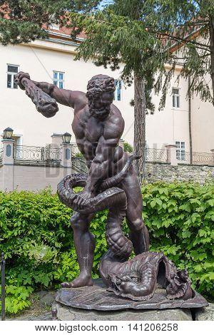 Uzhgorod Ukraine - April 27 2016: Sculpture of Heracles Lernaean Hydra and the territory of Uzhgorod castle