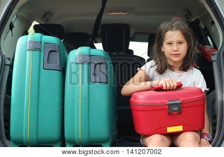 Beautiful Little Girl With Brown Hair Long Loads The Suitcase In