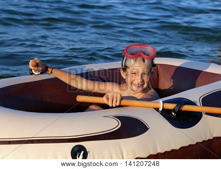 Little Girl With The Diving Mask On The Inflatable Dinghy At Sea