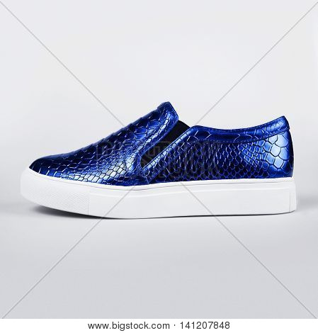 pair of new blue shoes in a grey background
