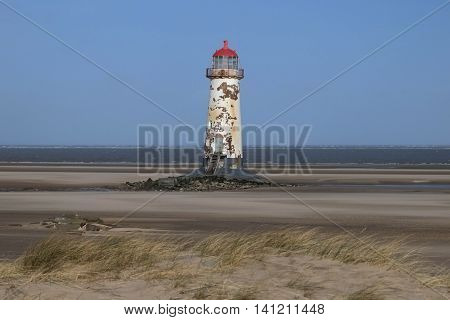 Built around 1776, The redundant lighthouse on the beach at Talacre, Flintshire, Wales. The foundations are now causing the lighthouse to tilt.