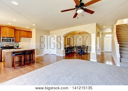 Open Floor Plan. View Of Kitchen, Dining Room And Entryway.
