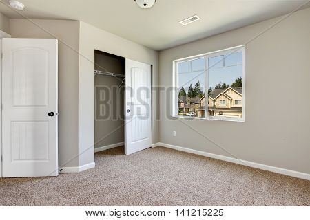 Small Empty Room With Window And Carpet Floor.