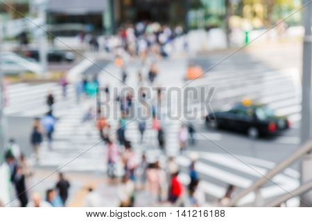 Abstract Blurred People Crossing The Street Outside