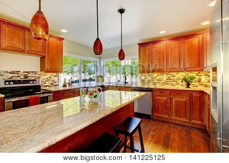 Practical Kitchen With Storage Combination And Granite Tops.