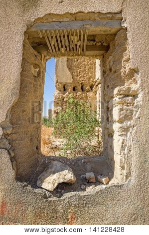 View Through Destroyed Window Of Ruins Of The  Abandoned Village Of Agios (saint) Sozomenos, Cyprus