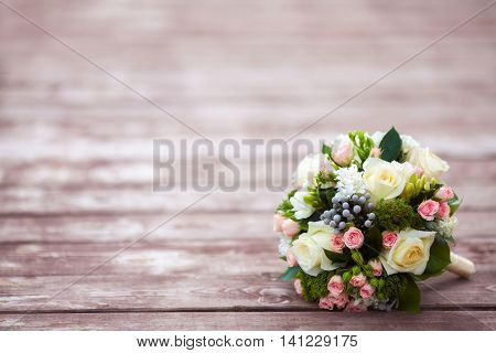 Beautiful wedding bouquet on vintage wooden background copy space. Marriage concept