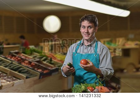 Grocery Clerk Juggling With Tomatoes In Supermarket Store