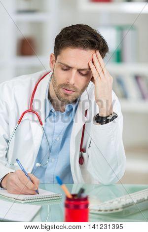portrait of doctor looking uneasy