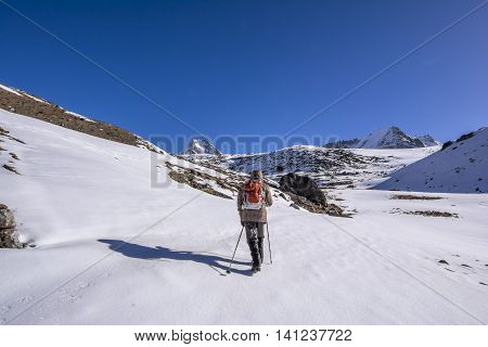 Everest Base Camp Trekking: solo trekker walking to final destination.