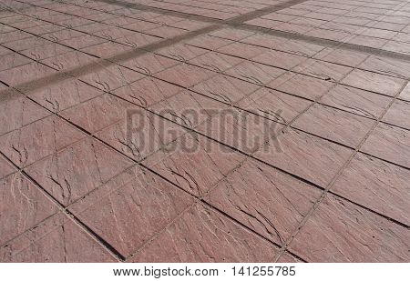 Stamped concrete floor outdoor pavement red square pattern with dilatation joint