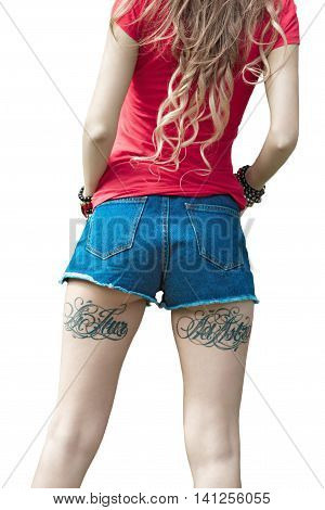 Sexy body of a woman in denim shorts and a red T-shirt. The model is back.