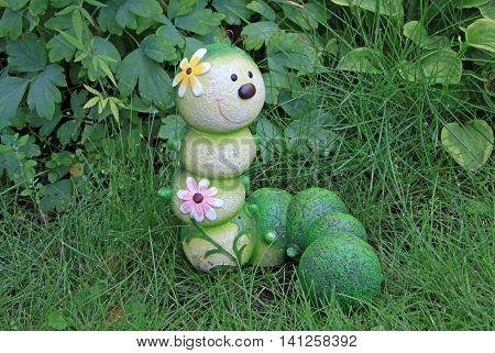 Caterpillar garden ornament decoration in a grass