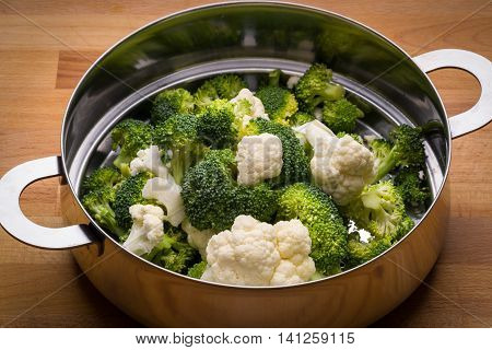 Fresh broccoli and cauliflower in stainless steel colander